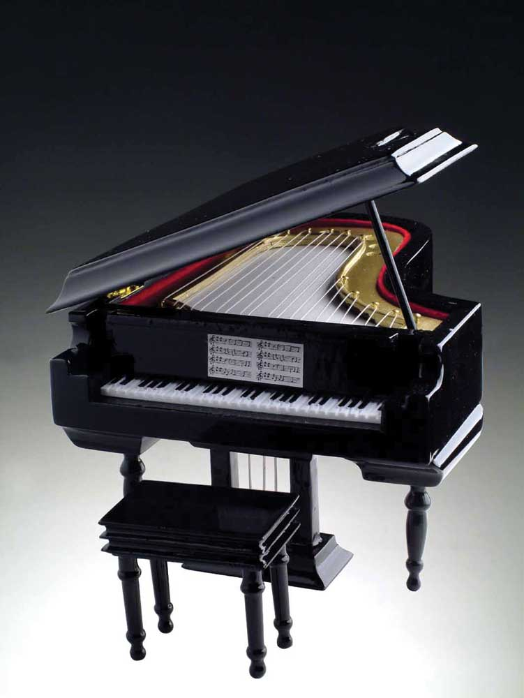 "Hand carved solid-wood piano with leatherette covered hinged box. Wind-up music box included.6.5""H x 8""L x 5 5/8"" W.Available in black; brown or white finish.Tunes vary by Piano Color:Black plays ""Fur Elise""White plays ""Fur Elise""Brown plays ""Waltz of the"